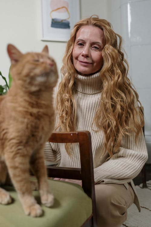 Woman with Her Orange Cat
