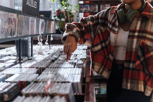Person Wearing a Checkered Shirt  in the Record store