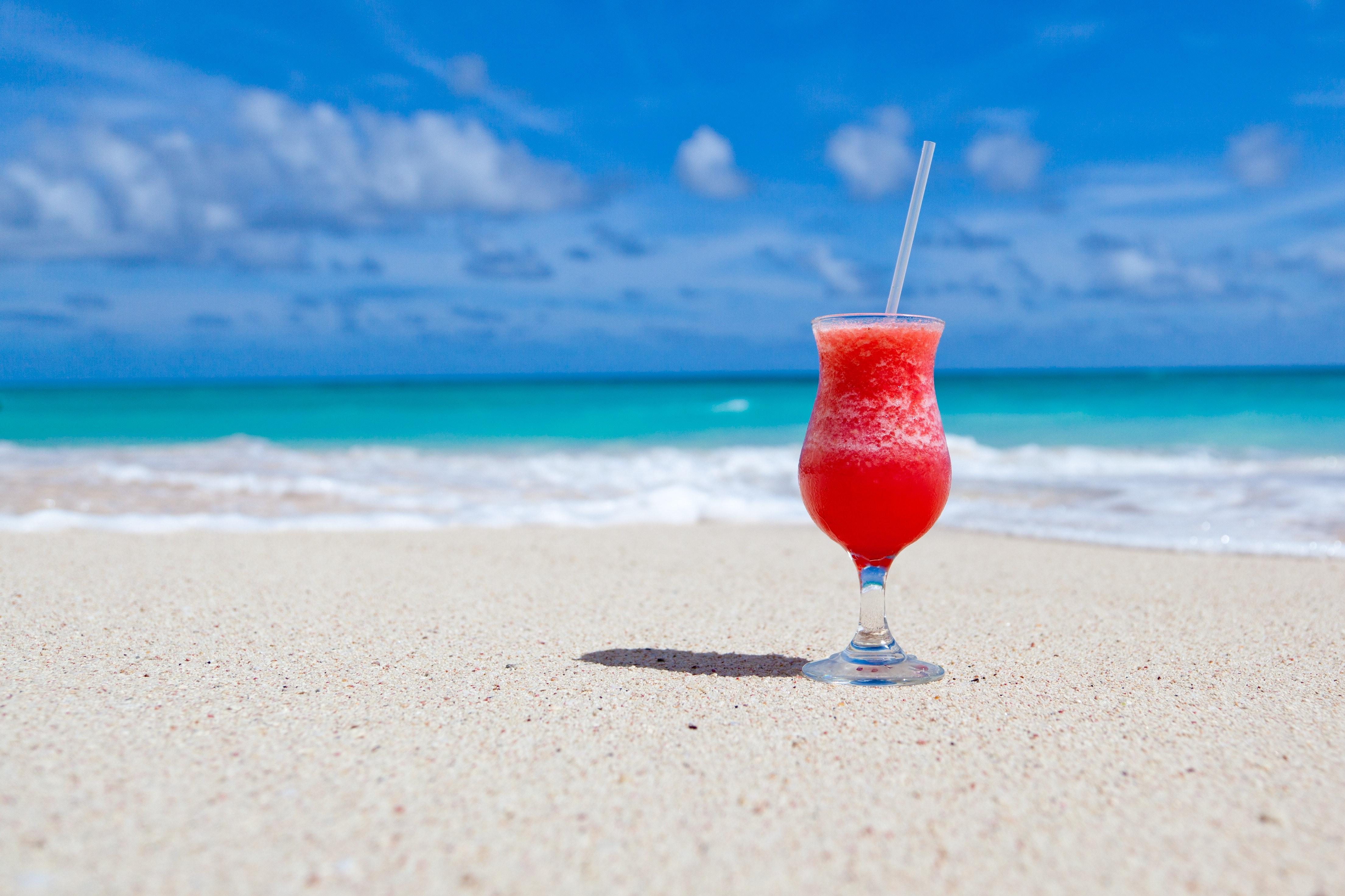 8af64dbb3b3b6 Red Slush Drink in Glass on Beach · Free Stock Photo
