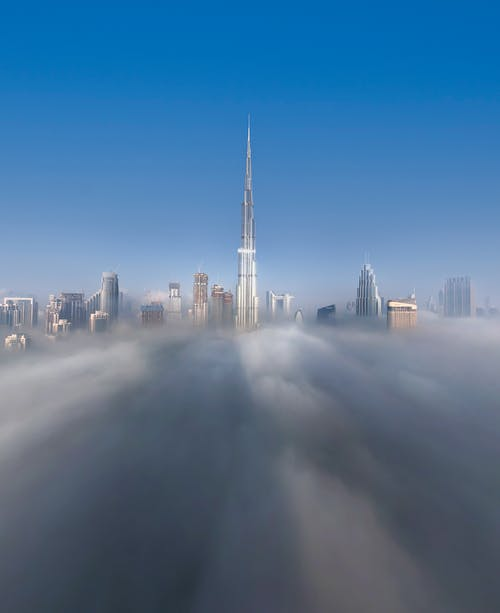 White Clouds over City Skyline