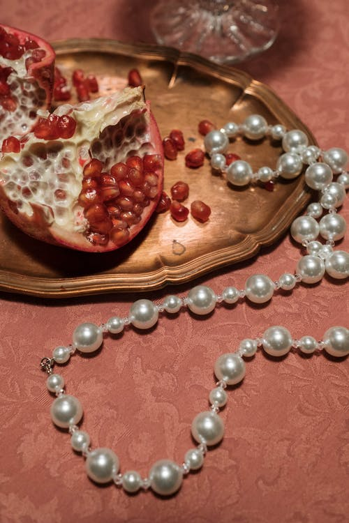 White Pearl Necklace on Table