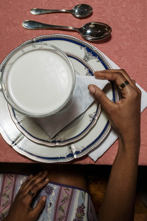 Person Holding White Ceramic Round Plate