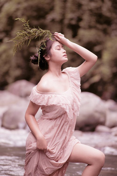 Woman in Pink Dress Holding Her Hair