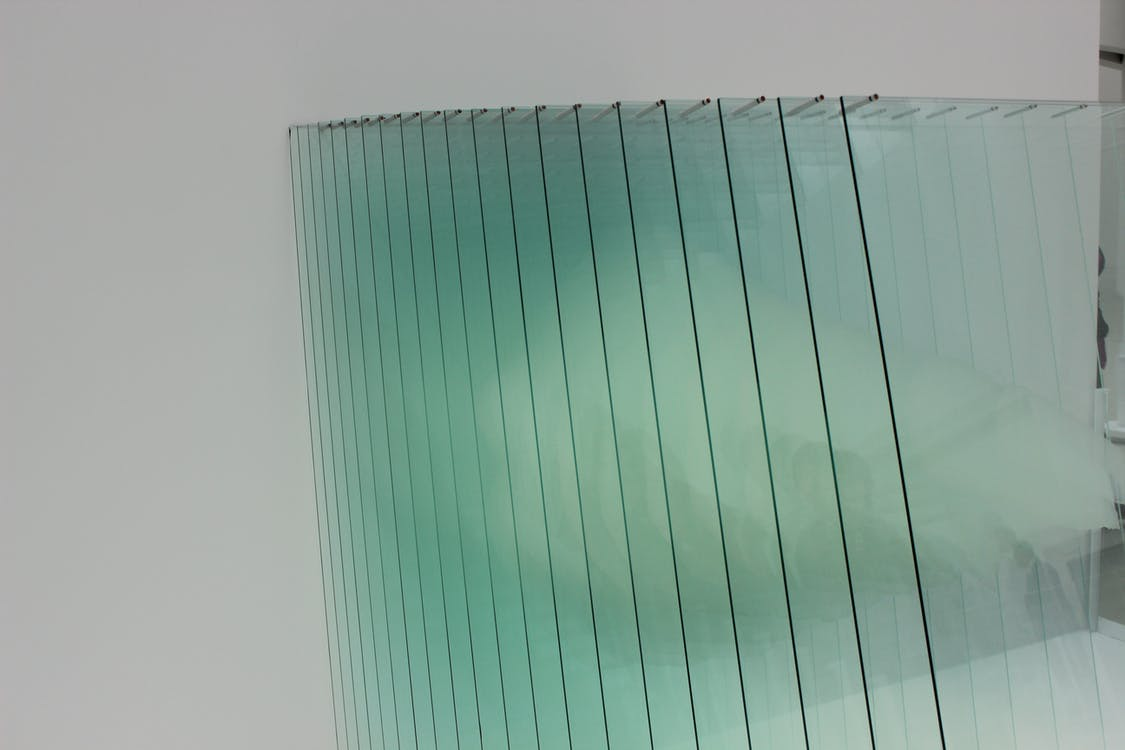 Clear Glass Panels on White Surface