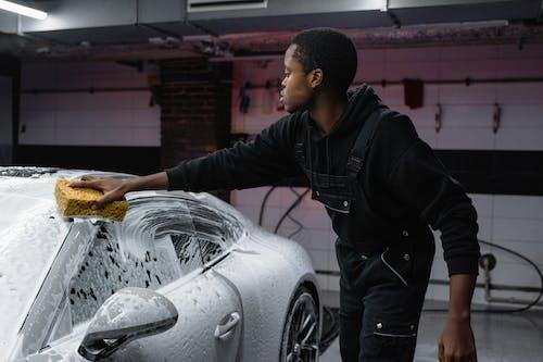 A Man Washing a Car