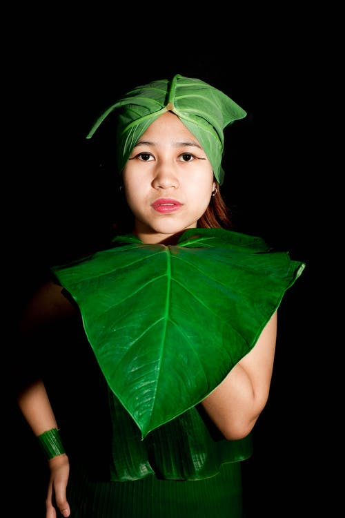 Woman With Green Leaves on Her Head