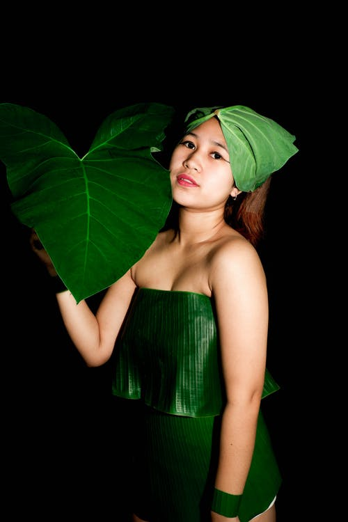 Woman in Green Tube Dress With Green Leaves on Her Head