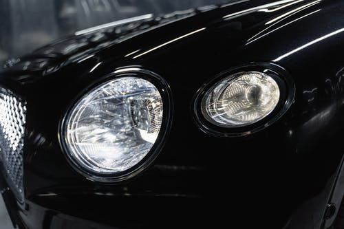 Front Headlight of a Black Car