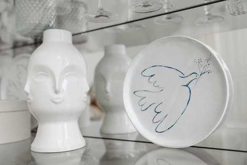 White Ceramic Display on the Glass Shelf