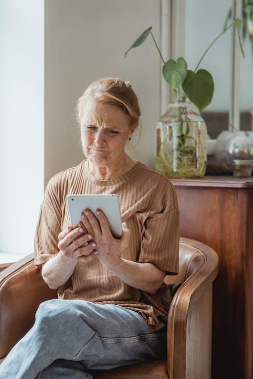 Senior woman having video call
