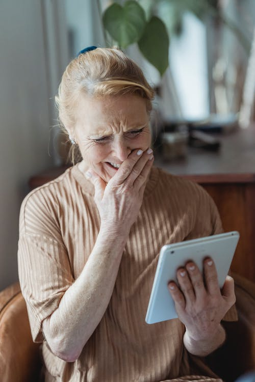Happy senior woman having video call