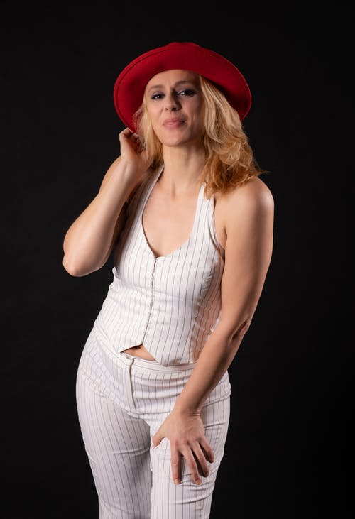 Free stock photo of blonde hair, cabaret, red and black background
