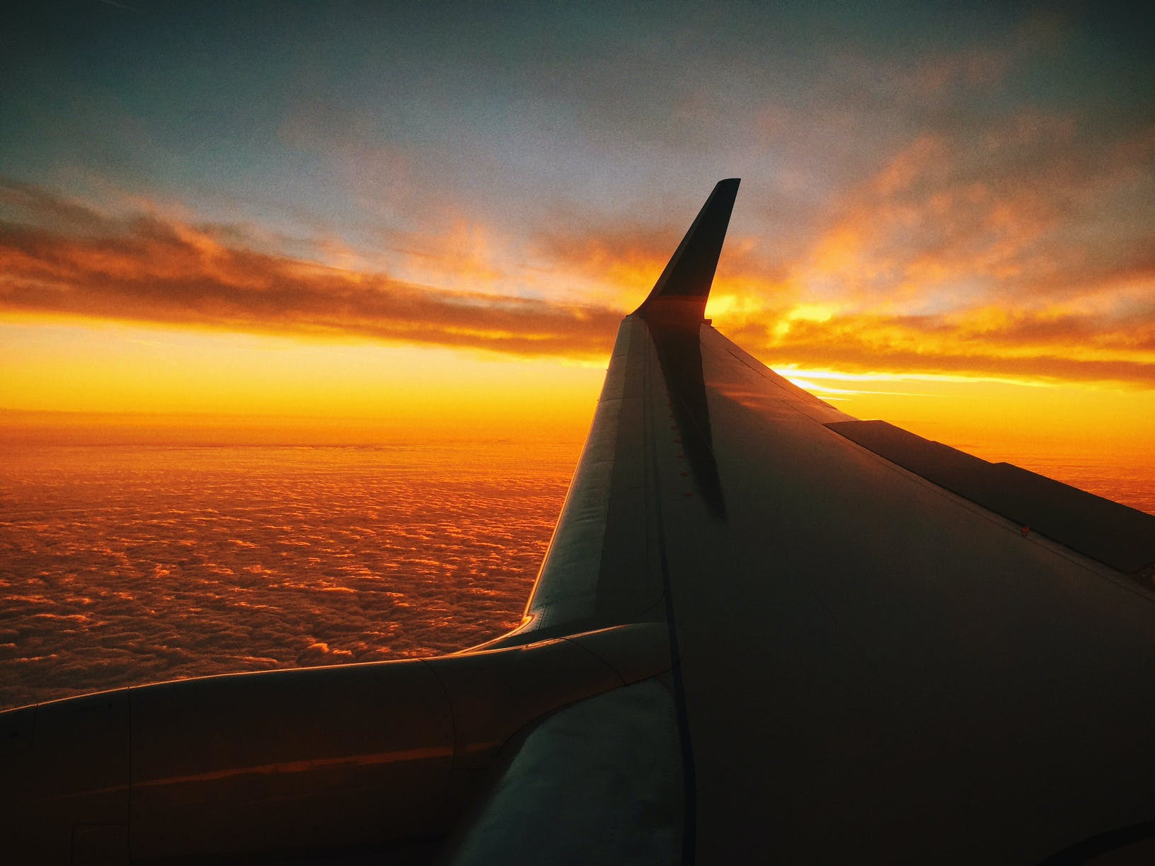 Free stock photo of flight, sunset, flying, clouds