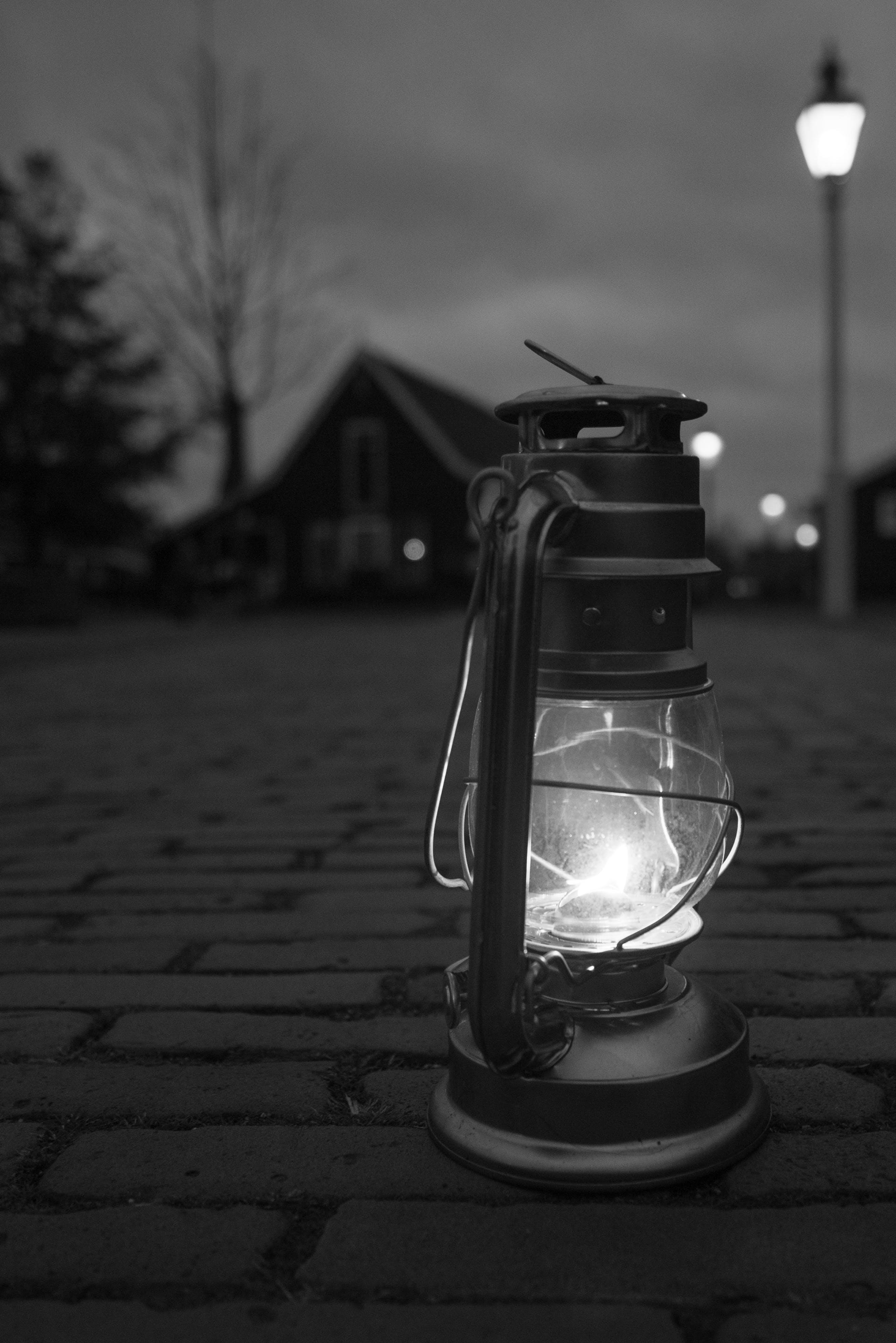 Greyscale Photography Of Lamp On Floor