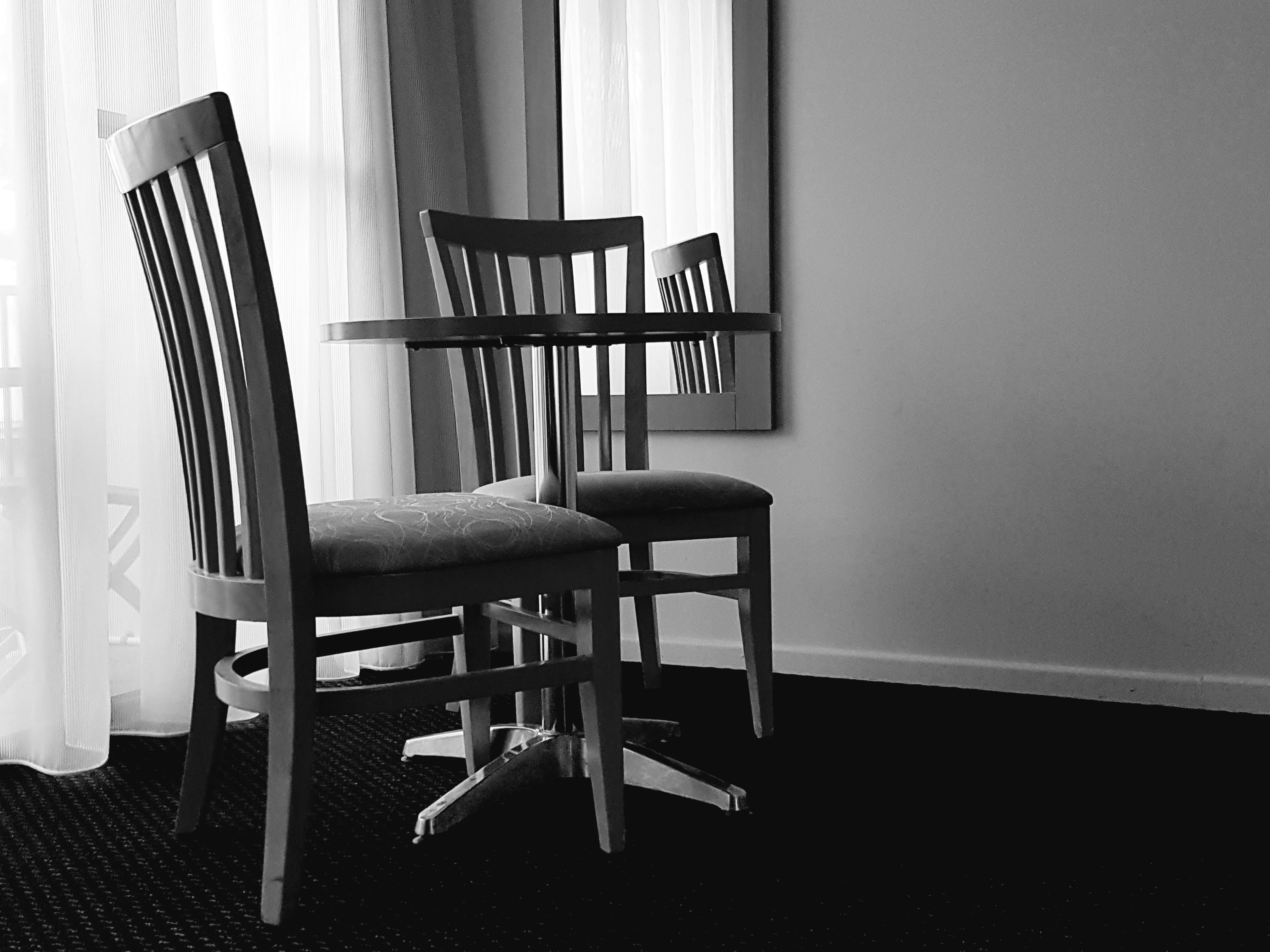Free stock photo of black and white, chairs, curtains, dinner table