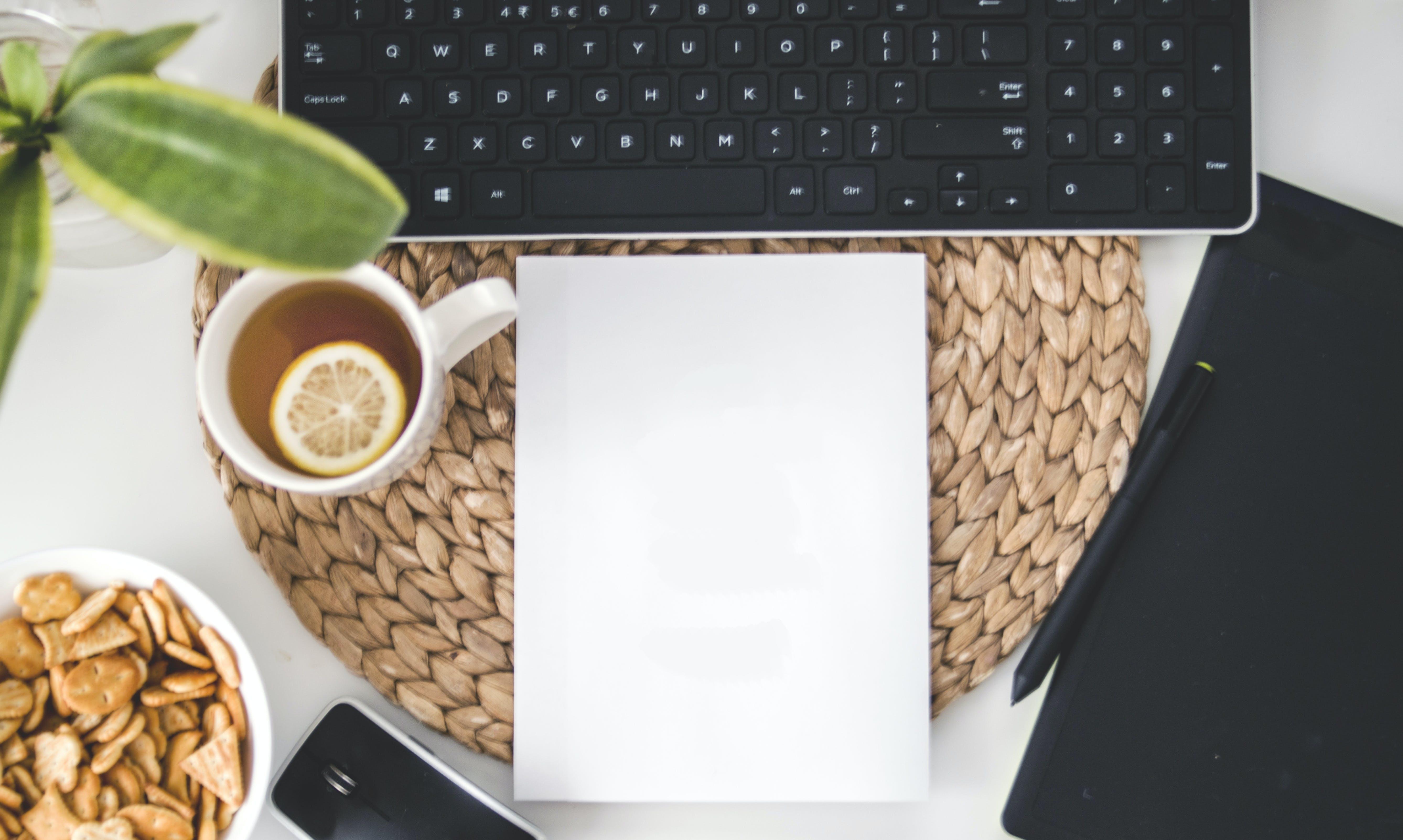 White Printing Paper Near Black Computer Keyboard