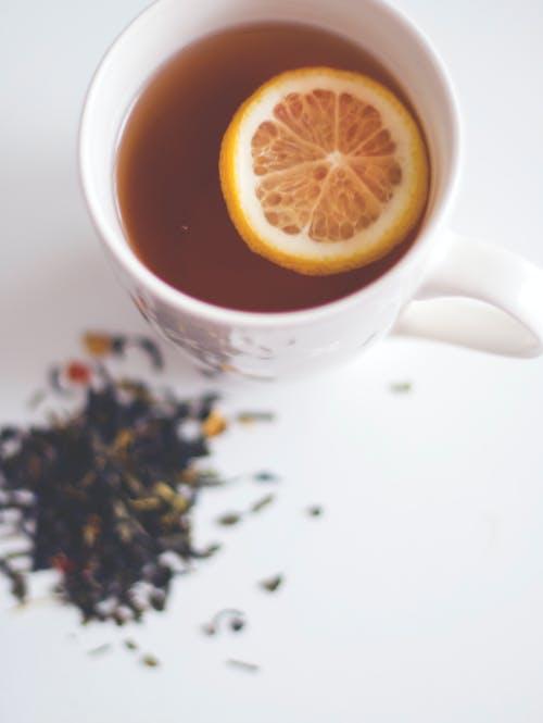 Free stock photo of cup, cup of tea, lemon, tea