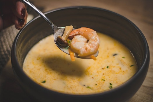Bowl of Shrimp Soup on Brown Wooden Surface