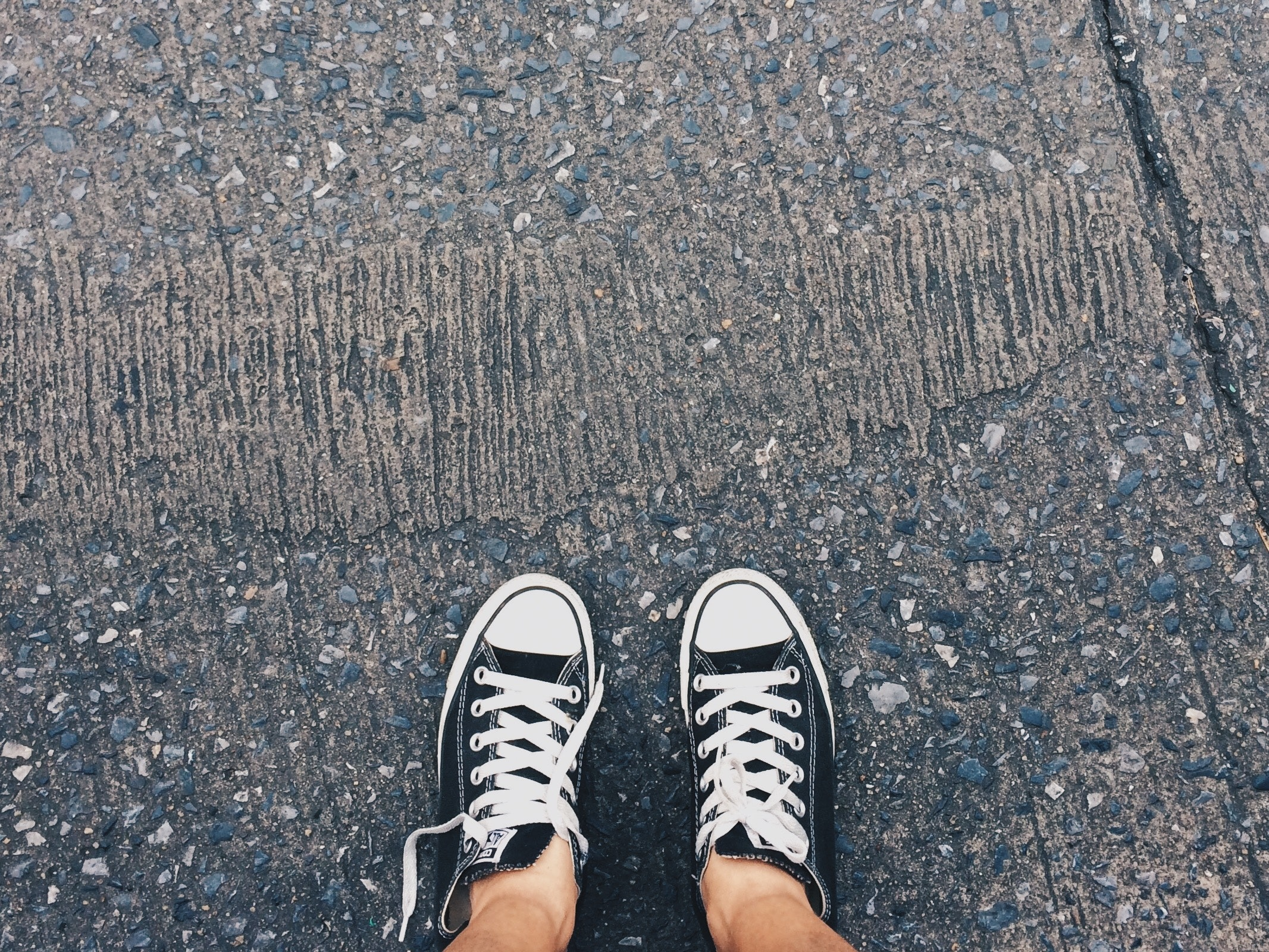 2cb3f9fe388 Person Wearing Pair of Black-and-white Converse All Star Low ...