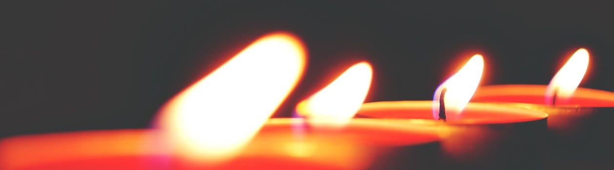 Closeup Photo of Four Tealight Candles