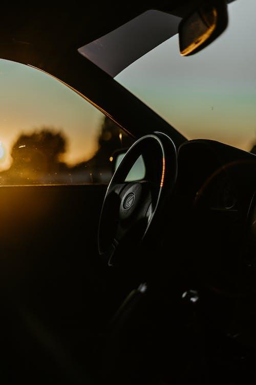 Black Car Side Mirror during Sunset