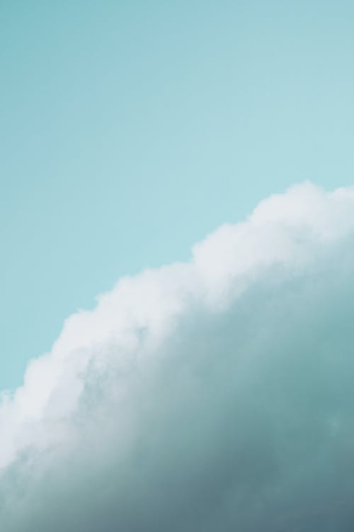 Fluffy clouds floating on blue sky
