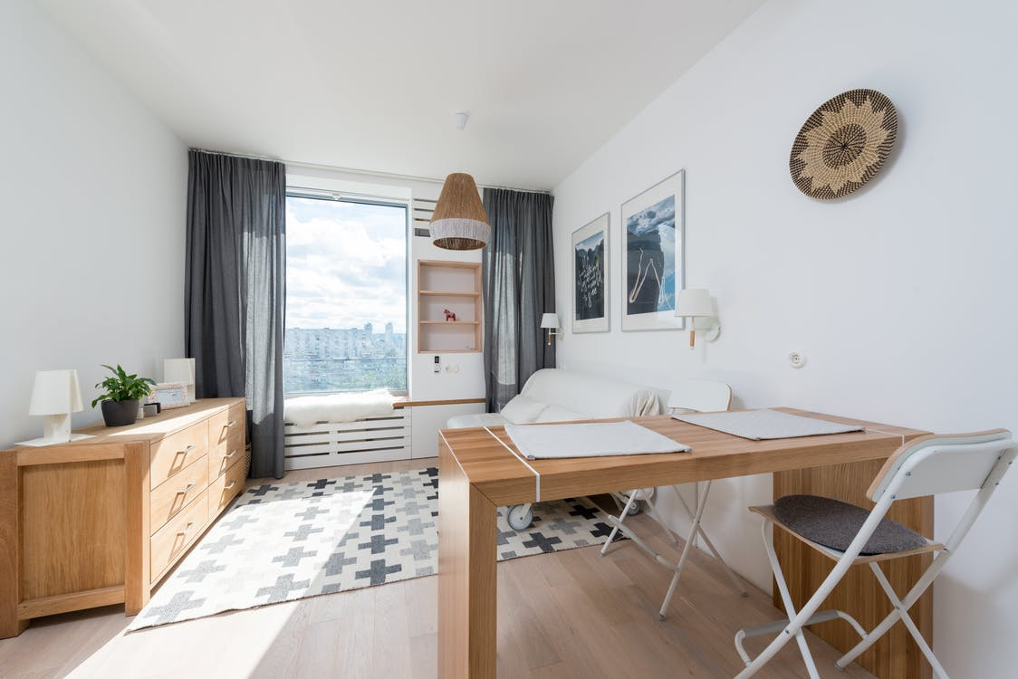 Interior of modern apartment with wooden furniture