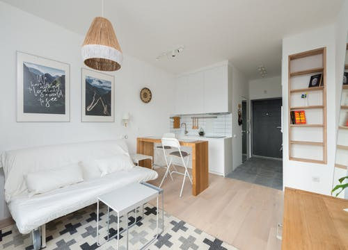 Light apartment with white walls and wooden furniture and decorative elements