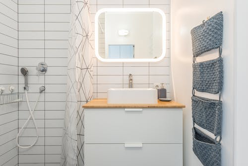 Small light bathroom with shower cabin