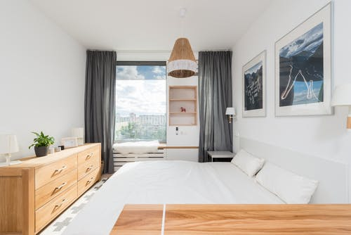 Cozy bedroom with modern furniture and decorative elements