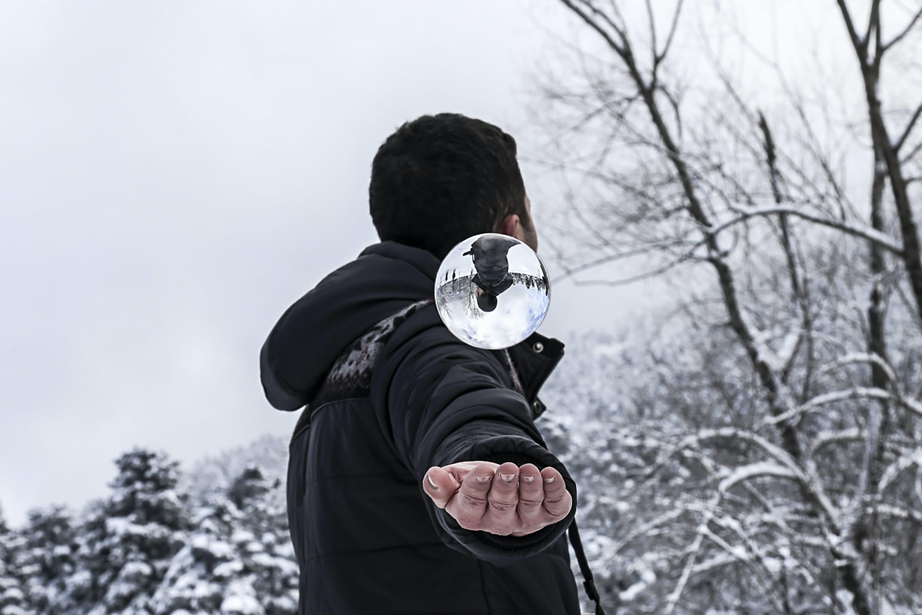 Man in Black Hoodie during Snow Weather at Daytime