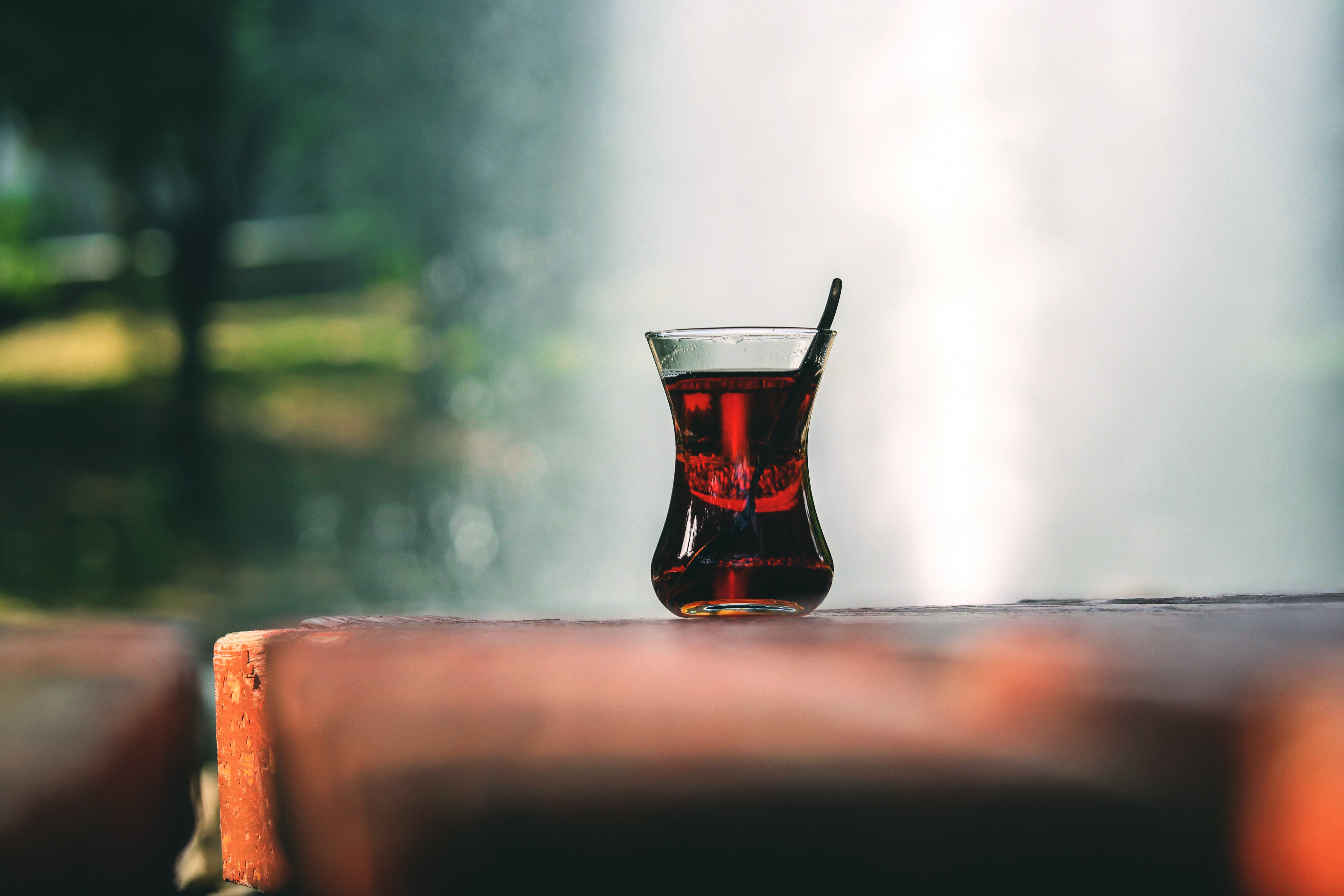Clear Turkey Tea Glass With Tea on Brown Wooden Table
