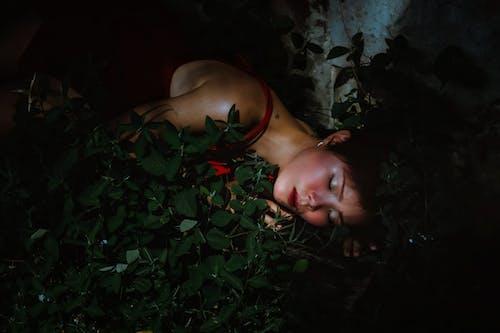 Topless Woman Lying on Green Grass