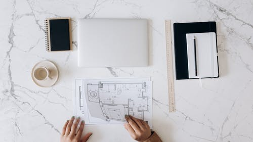 An Architect's Work Table With Tools and Blueprints