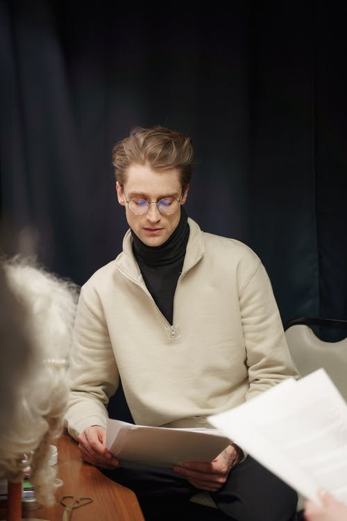 Man Sitting And Reading The Script