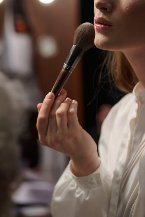 Crop Photo Of Woman Applying Makeup
