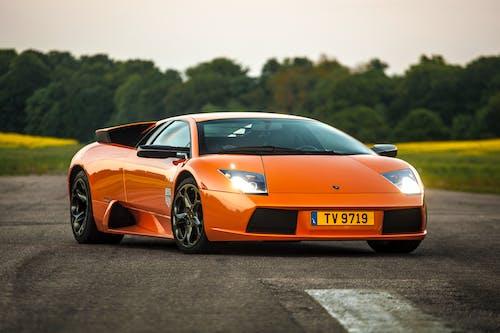 Orange Porsche 911 on Road