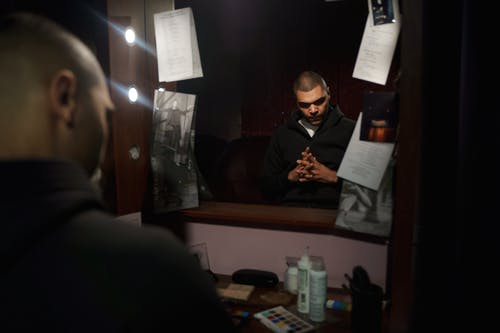 Reflection Of Man in Black Suit Jacket In The Mirror