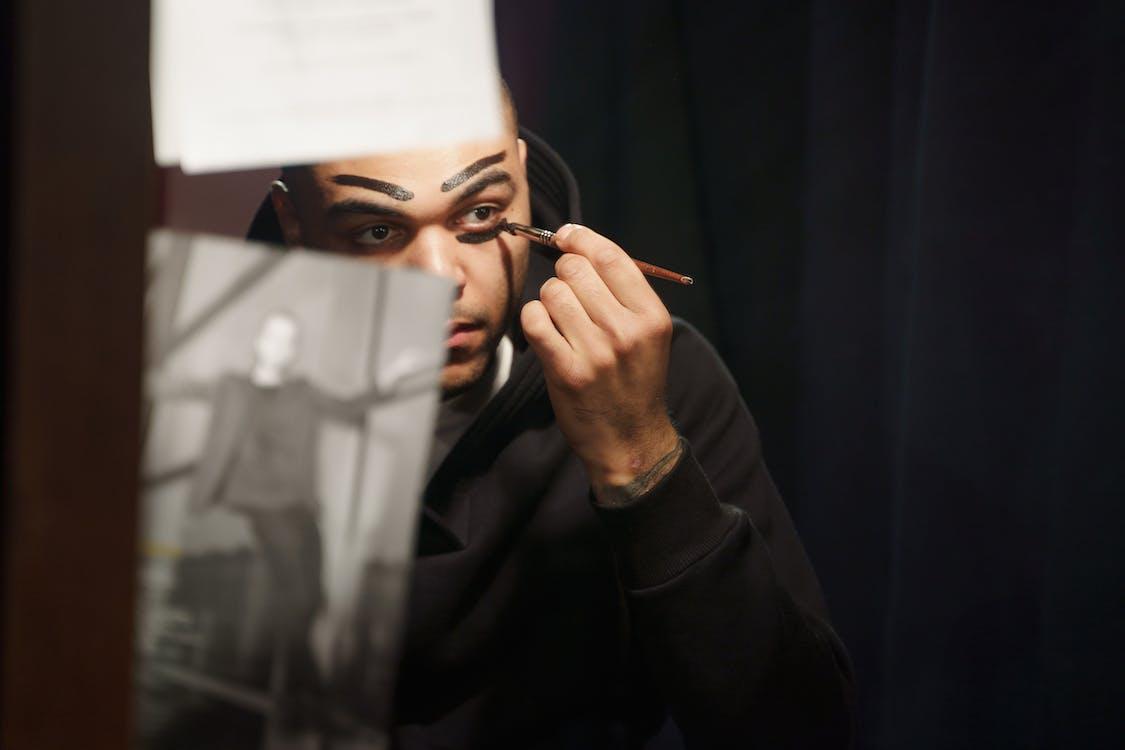Man Applying Makeup