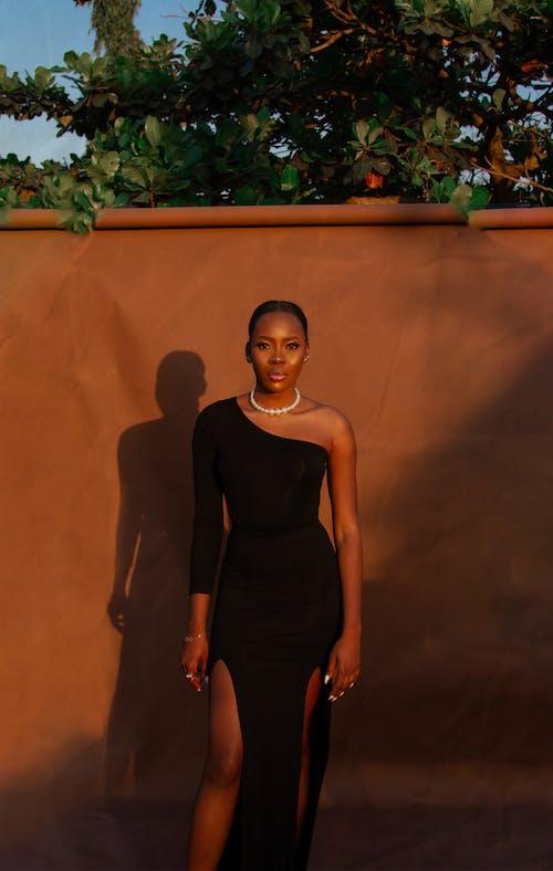 Woman in Black Spaghetti Strap Dress Standing