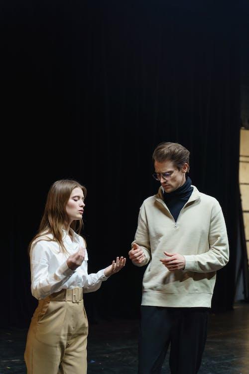 Woman Standing Beside A Man