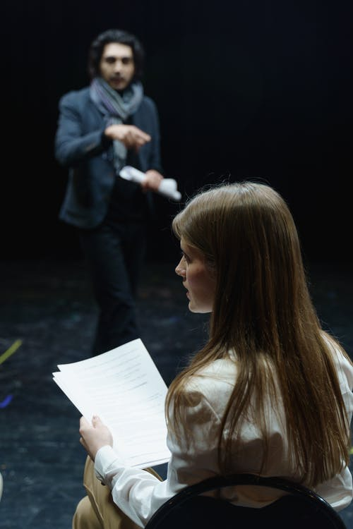 Woman Holding A Script