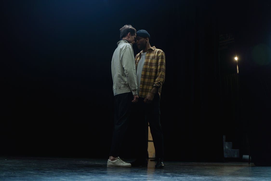 Two Men Acting On Stage