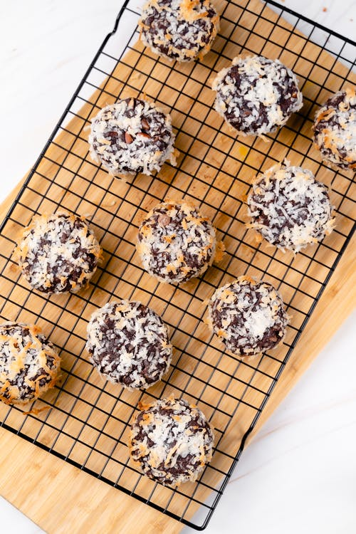 White and Black Cookies on Brown Wooden Tray