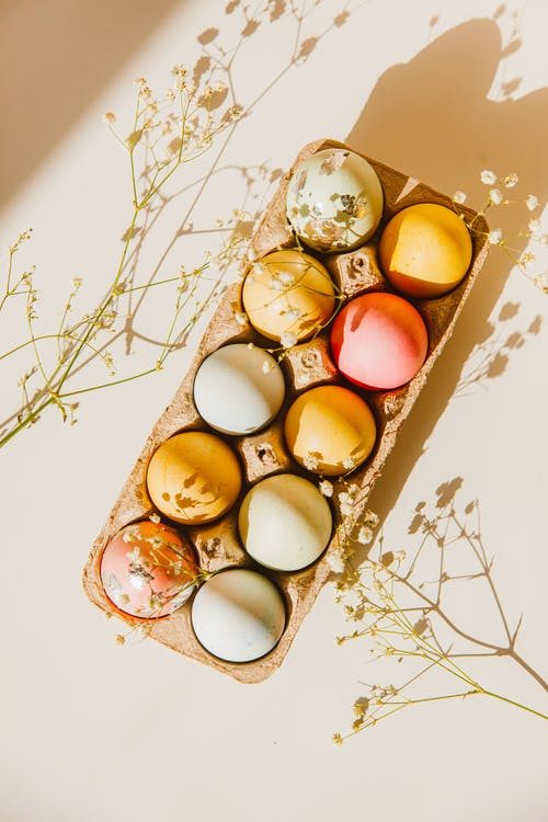 Colorful Eggs In A Carton