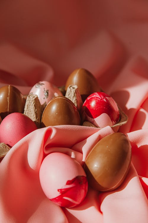 Brown and Pink Eggs on Pink Background