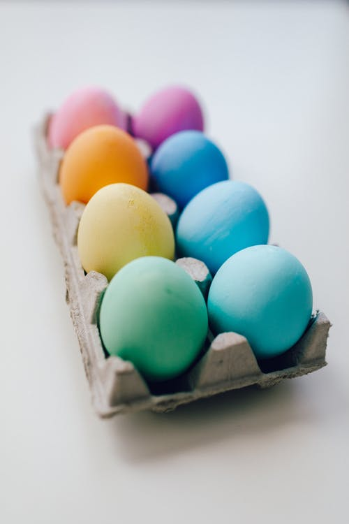 Colored Eggs On White Surface