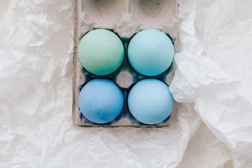 Blue Eggs On An Egg Carton