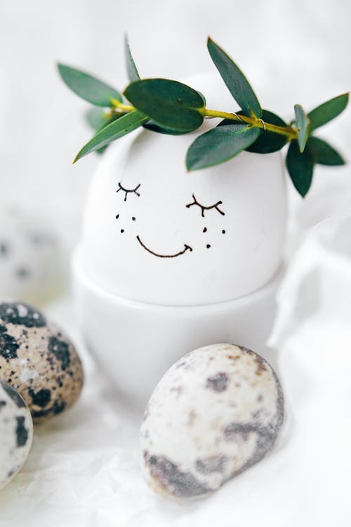 White Egg With Painted Face Emoji