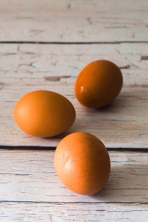 2 Brown Egg on Gray Wooden Table